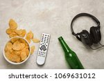 tv remote  a bowl of chips and... | Shutterstock . vector #1069631012