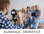 professional photographer... | Shutterstock . vector #1069657115