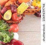 frame of fresh vegetables on a... | Shutterstock . vector #1069659746
