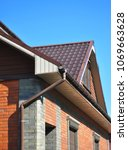 attic metal roof with brown... | Shutterstock . vector #1069663628