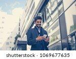 arabian businessman using smart ... | Shutterstock . vector #1069677635
