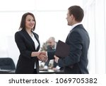 handshake business partners in... | Shutterstock . vector #1069705382
