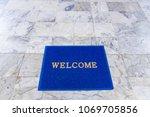 welcome mat on the floor... | Shutterstock . vector #1069705856