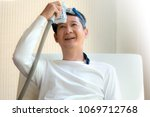 man laying in bed holding cpap... | Shutterstock . vector #1069712768