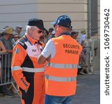 Small photo of LE MANS, FRANCE - JUNE 16, 2017: Back of a security guard and a pilot at the parade of pilots racing