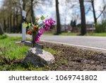 memorial cross with flowers at...   Shutterstock . vector #1069741802