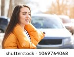 young woman using car alarm... | Shutterstock . vector #1069764068