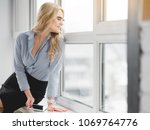 cheerful young businesswoman is ... | Shutterstock . vector #1069764776
