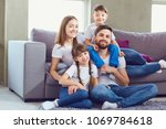 happy family smiling sitting at ... | Shutterstock . vector #1069784618