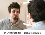 tired man who has just woken up ... | Shutterstock . vector #1069785398