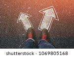 sneakers on the asphalt road... | Shutterstock . vector #1069805168