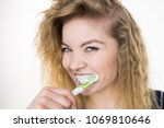 woman brushing cleaning teeth.... | Shutterstock . vector #1069810646