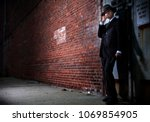 a 1940s style gangster on the... | Shutterstock . vector #1069854905