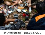 friends camping in the forest... | Shutterstock . vector #1069857272