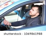 young man in car during traffic ... | Shutterstock . vector #1069861988