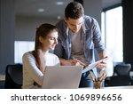 young smiling coworkers woman... | Shutterstock . vector #1069896656