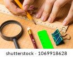 draftsman draws on a ruler on... | Shutterstock . vector #1069918628