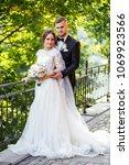walk the newlyweds. the bride... | Shutterstock . vector #1069923566