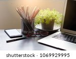 workplace at home.laptop with... | Shutterstock . vector #1069929995
