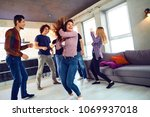 friends dance at a student's... | Shutterstock . vector #1069937018
