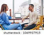 coworkers discussing plans of... | Shutterstock . vector #1069937915