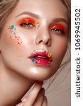 beautiful girl with art make up ... | Shutterstock . vector #1069945502