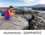 galapagos tourist photographer... | Shutterstock . vector #1069946552