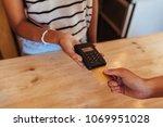 woman entrepreneur using a... | Shutterstock . vector #1069951028