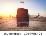 suitcase on airport and free... | Shutterstock . vector #1069956425