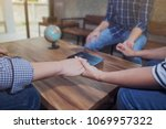 man and woman holding hands... | Shutterstock . vector #1069957322