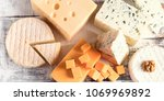 different kinds of cheeses on... | Shutterstock . vector #1069969892