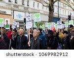 London, United Kingdom, 14th April 2018:- Marchers on a silent march from Kensington Town Hall to the ruins of Grenfell tower ten months on from the devastating fire that killed 71 - stock photo