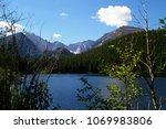 a clear blue mounatin lake in... | Shutterstock . vector #1069983806