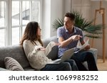 young couple arguing about high ... | Shutterstock . vector #1069985252