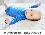 adorable two months baby girl... | Shutterstock . vector #1069995785