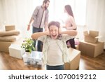 young parents are fighting with ... | Shutterstock . vector #1070019212