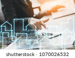 closeup hand finger point to... | Shutterstock . vector #1070026532
