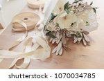 beautiful white beige bouquet... | Shutterstock . vector #1070034785