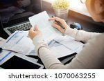 asian woman looking to saving... | Shutterstock . vector #1070063255