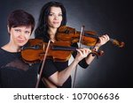 Two Beautiful Woman Playing Th...