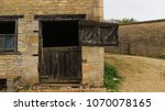 stable with stable door open on ... | Shutterstock . vector #1070078165