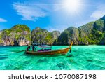 traditional long tail boat on... | Shutterstock . vector #1070087198