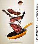 flying pieces of beef steaks...   Shutterstock . vector #1070095178