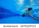 underwater shot of fit swimmer...   Shutterstock . vector #1070109515