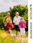 family jogging for sport... | Shutterstock . vector #107013878