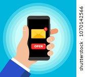 hand holding black mobile phone ... | Shutterstock .eps vector #1070142566