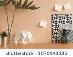 pastel orange desk with leafs ... | Shutterstock . vector #1070143535