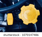 Small photo of dipstick and oil cap of a car combustion engine