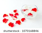 rose petals in a bowl with... | Shutterstock . vector #1070168846