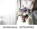 brides wedding bouquet with... | Shutterstock . vector #1070169062